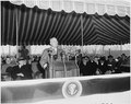 Photograph of President Truman delivering a speech that was broadcast around the world from the deck of the U.S.... - NARA - 200344.tif