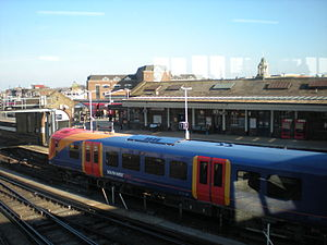 English: A train arrives at Clapham Junction P...