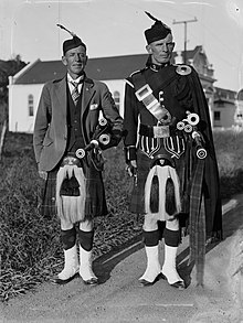 110b1054d Two men dressed in traditional Scottish wear.