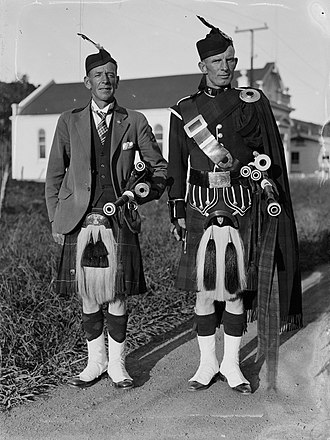 Dress code - Two men dressed in traditional Scottish wear.