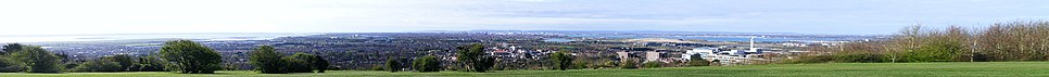 Panorama of Portsmouth from Portsdown Hill. To the left lies Langstone Harbour along with Hayling Island, and to the right lies Portsmouth Harbour.