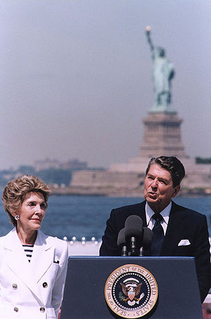 Liberty Weekend - President Ronald Reagan on Governors Island delivering a speech; First Lady Nancy Reagan is to the left. July 4, 1986.