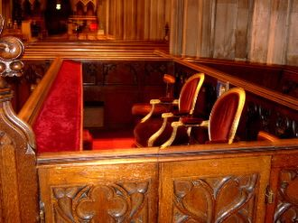 St Patrick's Cathedral, Dublin - State pew of the President of Ireland, still retains a British Standard carving on the front