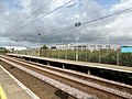 Prestwick International Airport railway station - view towards Troon with airport buildings.jpg