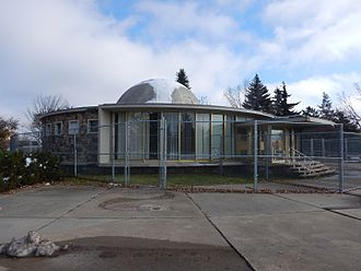 Queen Elizabeth Planetarium - The Queen Elizabeth Planetarium in October 2016. The building is surrounded by a wire fence due to its dilapidation.