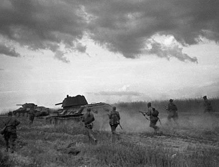 Soviet soldiers and T-34 tanks advance in skirmish near Bryansk in 1942. RIAN archive 613694 Red Army men are on offensive near Bryansk.jpg