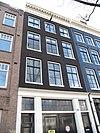 foto van Huis met gevel onder rechte lijst en met bedrijfspui