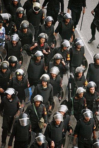 """Central Security Forces - Police in riot gear on 28th of January - """"The Day of Rage"""" - during the Egyptian Revolution of 2011."""