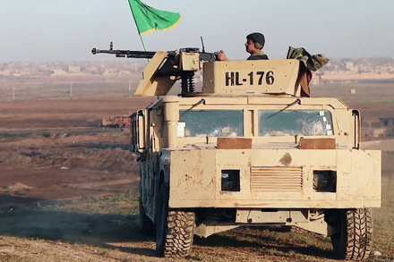 SDF gunner firing towards the ISIL camp, 4 March 2019 SDF MG in Baghuz, 4 March 2019.png