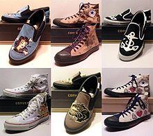 A Line Of Converse Shoes Depicting Some Sailor Jerrys Original Tattoo Artwork