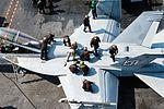 Sailors clean an F-A-18F Super Hornet on the flight deck of the aircraft carrier USS John C. Stennis. (25400692874).jpg