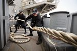 Sailors heave a mooring line on the fantail of USS Bonhomme Richard. (33168964755).jpg