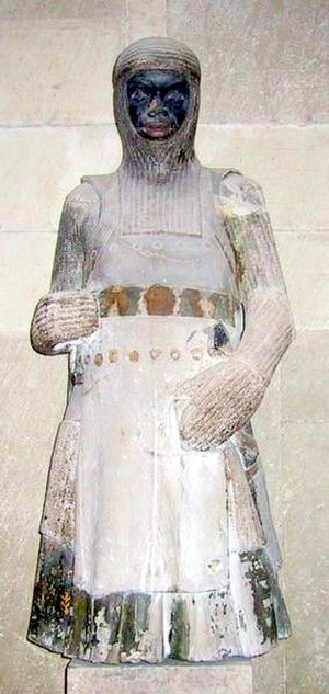 Coat of plates - Mid 13th century statue of saint Maurice in the Magdeburg Cathedral, Germany, wearing a coat of plates above his Hauberk and with a mail coif on top.