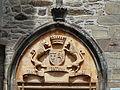 Sainte-Fortunade château porte tympan.JPG