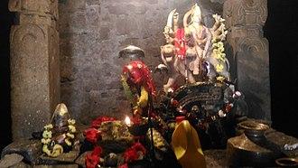 Binsar Devta - Sanctum Sanctorum of the temple with carved monolithic pillars