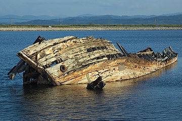 Scrapped ship with a blue rock-thrush, Matsue City, Shimane Prefecture, October 2014.jpg