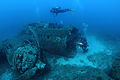 Scuba divers on the wreck of a B-17 bomber.JPG