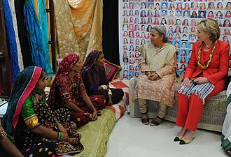Self Employed Women's Association - U.S. Secretary of State Hillary Rodham Clinton and SEWA Executive Director Reema Nanavaty listen as women artisans share stories of their involvement with SEWA at the Hansiba Store in Mumbai, India July 18, 2009.