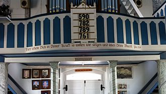 Serbin, Texas - Interior of the church, facing the rear. The Bible verse in German, not Wendish/Sorbian.