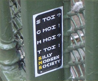 "Text messaging - This sticker seen in Paris satirizes the popularity of communication in SMS shorthand. In French: ""Is that you? / It's me! / Do you love me? / Shut up!"""
