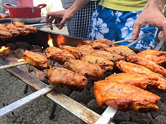 Chicken as food - Chicken wings being barbequed
