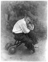 Small boy on kiddie car, photograph by Doris Ulmann - LoC 3a36062u.jpg