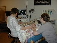 Sonographer doing pediatric echocardiography.JPG