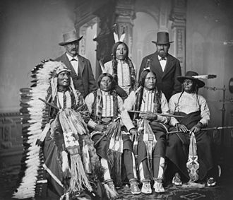 Touch the Clouds - Touch the Clouds (seated at left with headdress), photo taken fall 1877, during his visit to Washington, D.C. as a delegate to meet with President Hayes.