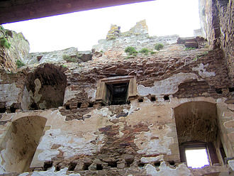 Spynie Palace - Interior of David's Tower showing put-log holes for floors and plastered walls