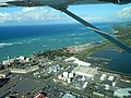 Starr-141025-2602-Casuarina equisetifolia-aerial view fuel tanks utilities sewage treatment and Kanaha Pond-Kahului-Maui (24617373914).jpg