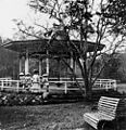 StateLibQld 1 16398 Woman and four girls standing next to the Band Stand in the Botanic Gardens in Brisbane, 1910.jpg