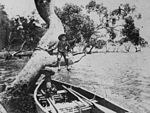 StateLibQld 2 113436 Two boys with a rowboat at Wellington Point, Brisbane, 1890-1900.jpg