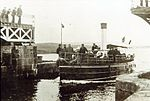 Steamer belonging to Bernard Forbes, 8th Earl of Granard, passing through Lanesborough Bridge in 1900.jpg