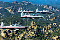 A four-ship formation of T-6A Texan II based at Vance AFB.