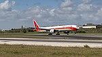 TAAG 777-300ER rocketing out of Lisbon (46832255454).jpg