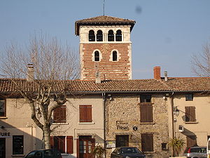 Ternay, Rhône - The main square and the church tower