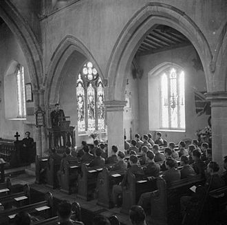 Thanksgiving Day service for members of the United States Army Air Corps, held in a church in Cransley, Northamptonshire, England, November 23, 1944 Thanksgiving Day Service Held in English Country Church- Americans in Cransley, Northamptonshire, England, UK, 23 November 1944 D22929.jpg