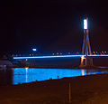 The Mekong, people in the water and the bridge light show.jpg