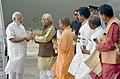 The Prime Minister, Shri Narendra Modi being welcomed by the Governor of Uttar Pradesh, Shri Ram Naik and the Chief Minister, Uttar Pradesh, Yogi Adityanath, on his arrival, in Varanasi, Uttar Pradesh on September 22, 2017.jpg