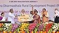 The Prime Minister, Shri Narendra Modi distributing the RuPay cards to beneficiaries, at the Shri Kshetra Dharmasthala Rural Development Project, at Ujire, in Karnataka.jpg