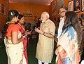 The Prime Minister, Shri Narendra Modi interacting with the Anganwadi workers, at the Model Anganwadi Centre, at Jangla, in Bijapur, Chhattisgarh.jpg