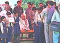 The Prime Minister Shri Atal Bihari Vajpayee is greeted by a delegation of handicapped children on the occasion of Holi in New Delhi on March 7, 2004.jpg