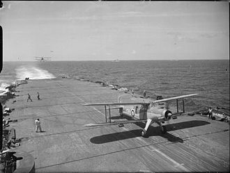 HMS Formidable (67) - An Albacore taxiing forward and another about to land