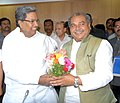 The Union Minister for Mines, Steel and Labour & Employment, Shri Narendra Singh Tomar meeting the Chief Minister of Karnataka, Shri Siddaramaiah, in Bangalore on July 04, 2014.jpg