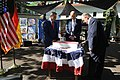 Timothy Eydelnant, Bernd Wiegand, and Reiner Haseloff cut the Independence Day Cake.jpg