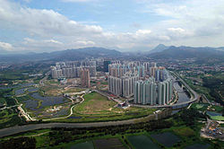 Aerial view of Tin Shui Wai; Hong Kong Wetland Park on the left