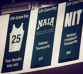 Bennett's retired #25 hangs in the rafters of the Resch Center, the home court of the Green Bay Phoenix. Bennett holds 1st place all-time for the Phoenix in both scoring and assists. TonyBennettRetiredJerseyReschCenter.jpg