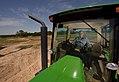 Tractor plows field. (24485452993).jpg