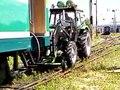 File:Traktor pulling a train.ogv