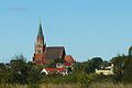 Trzebiatow church from rail line.JPG